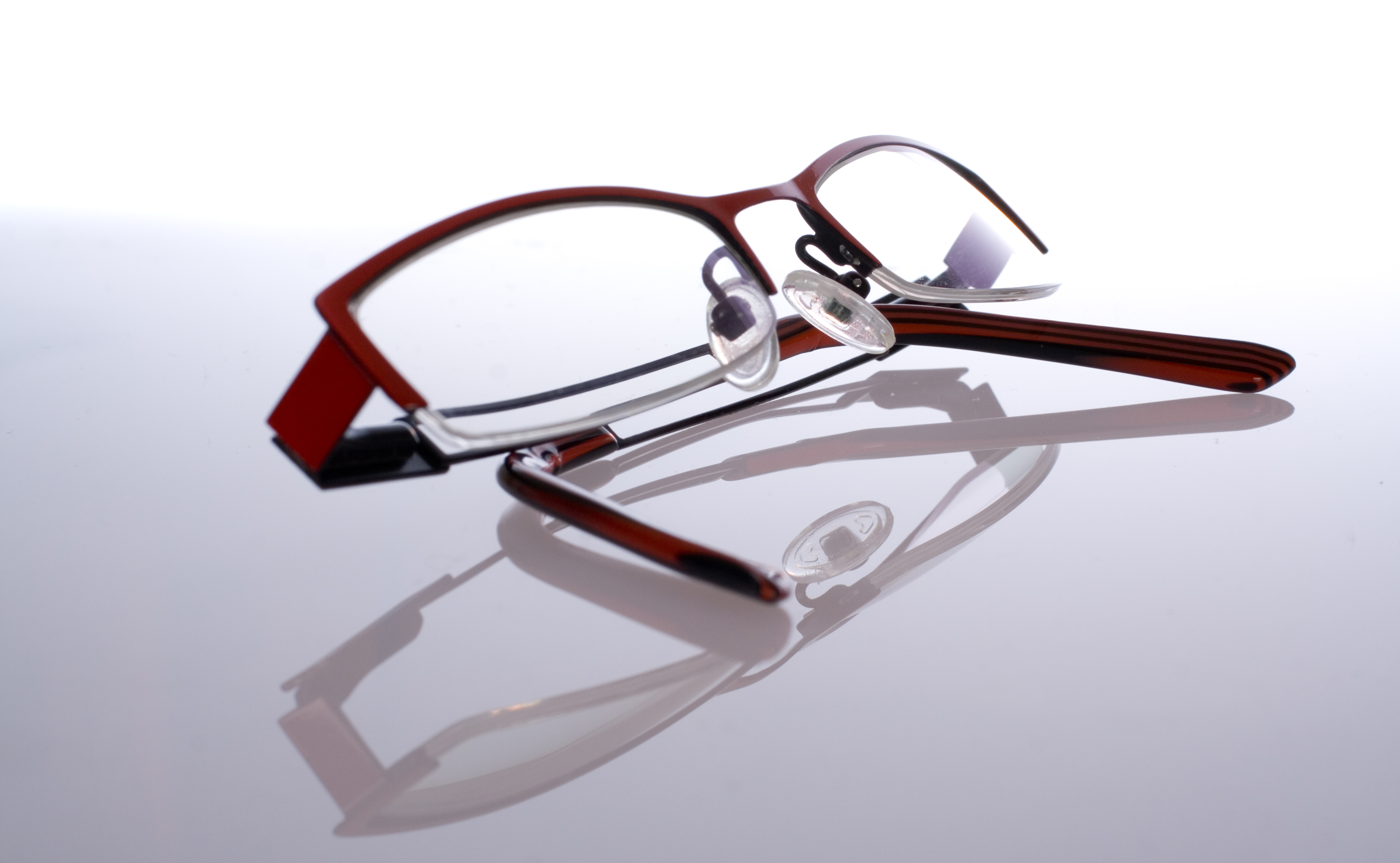 pair of spectacles on white with reflection